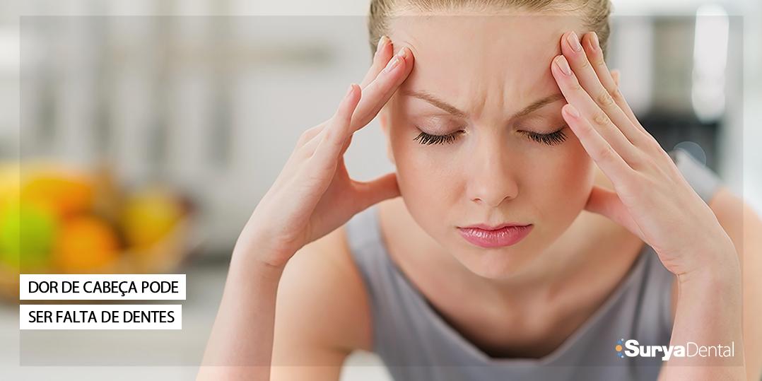 Dor de cabeça pode ser causada por falta de dente
